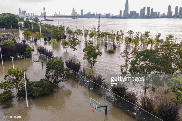 This aerial photo taken on July 28, 2020 shows a flooded sports ground along the Yangtze River in Wuhan in China's central Hubei province. / China OUT