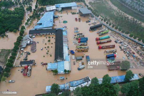 This aerial photo taken on July 7, 2020 shows inundated buildings and vehicles after heavy rain caused flooding in Shexian county, Huangshan city, in...