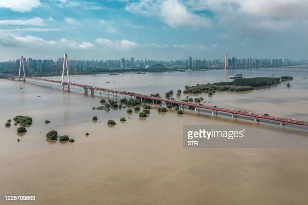 This aerial photo taken on July 8, 2020 shows trees and streets inundated by floodwaters from the swollen Yangtze River following seasonal rains in...
