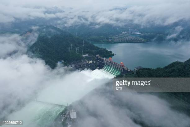 This aerial photo taken on July 8, 2020 shows water being released from the Xinan River Dam in Jiande in Hangzhou city, in China's eastern Zhejiang...