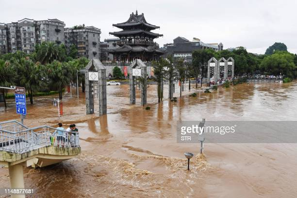 This aerial photo taken on June 9 2019 shows streets submerged by floodwater in Guilin in China's southern Guangxi region after heavy rainstorm hit...