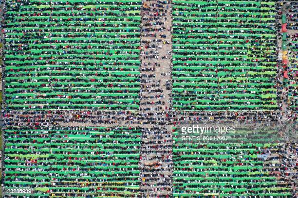 This aerial photo taken on May 13 shows Albanian Muslims praying at Skenderbej square on the first day of the Muslim festival marking the end of the...