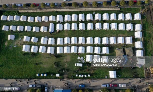 This aerial photo taken on November 27, 2019 shows a view of the makeshift camp in Thumane, northwest of capital Tirana, after an earthquake hit...