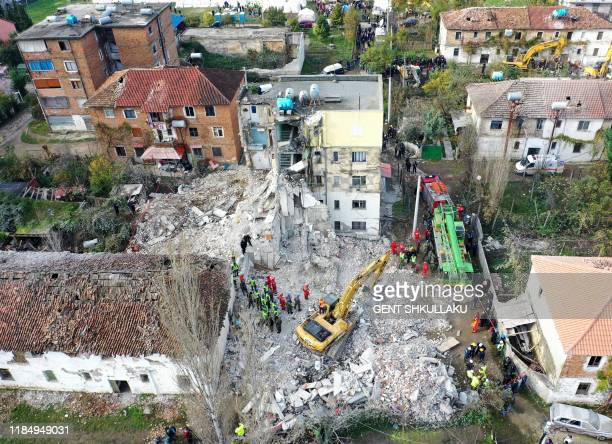 This aerial photo taken on November 27, 2019 shows emergency workers during an operation at a collapsed building in Thumane, northwest of capital...
