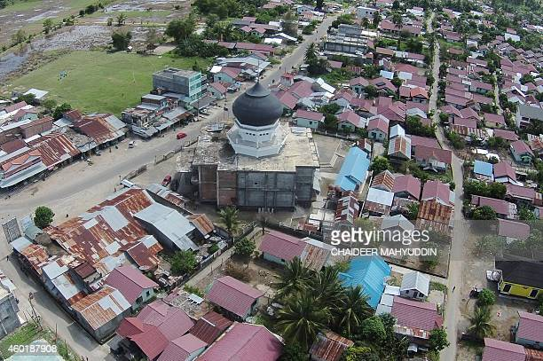 This aerial photo taken on November 29 2014 shows the renovated mosque in Teunom in Aceh Jaya district surrounded by new houses and a rebuilt...