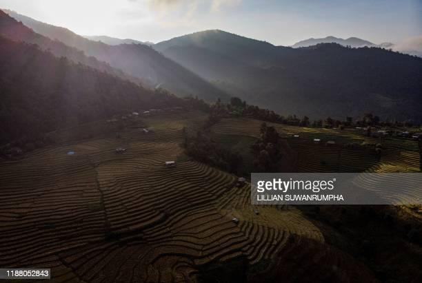 This aerial photo taken on November 7 2019 shows rice terraces in the village of Mae Rim in the northern Thai province of Chiang Mai Battling drought...
