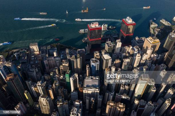 This aerial photo taken on October 30 2018 shows marine vessels sailing on Victoria harbour past commercial and residential buildings including the...
