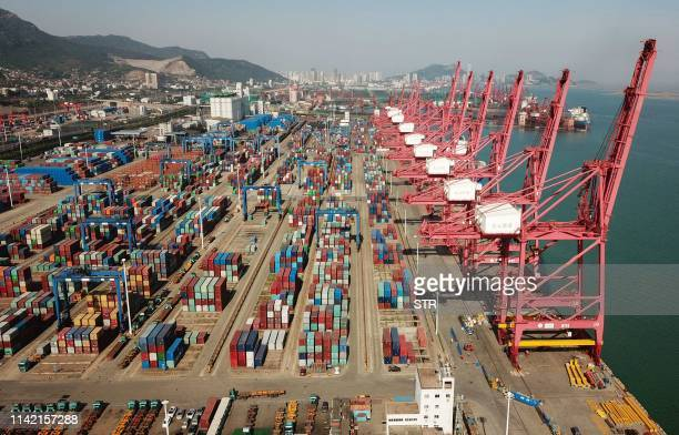 This aerial photo taken on on May 8 2019 shows a port in Lianyungang in China's eastern Jiangsu province China's exports fell more than expected in...