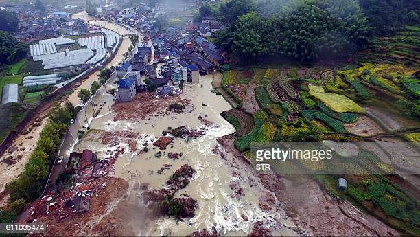 TOPSHOT This aerial photo taken on September 29 2016 shows a view of a landslide area in the village of Sucun in Suichang county east China's...