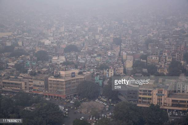 This aerial photograph shows heavy pollution smog covering the capital city of Delhi on November 1, 2019.