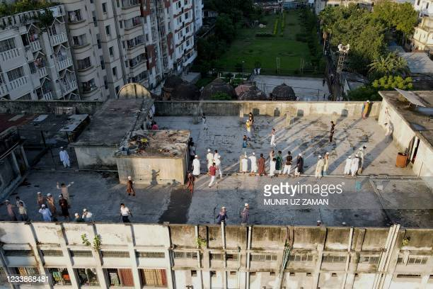 This aerial photograph shows madrasa students playing on a rooftop during a nationwide lockdown imposed to curb the spread the Covid-19 coronavirus...