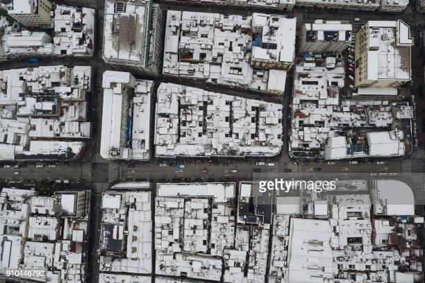 This aerial photograph shows snow on rooftops in Shanghai on January 26 2018 China's central and eastern regions have been hit by heavy snowfalls in...
