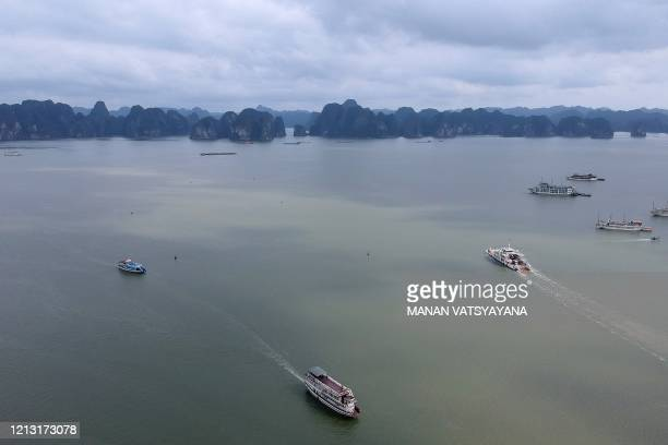 This aerial photograph shows tourist boats in the waters of Ha Long Bay in northeastern province of Quang Ninh on May 16 2020