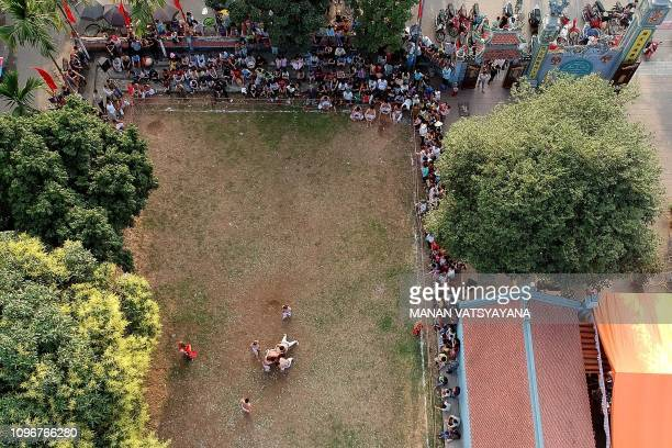 This aerial photograph taken on February 9 2019 shows Vietnamese men wrestling for the prized jackfruit wooden ball during the traditional 'Vat Cau'...