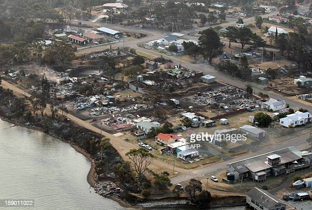 This aerial photograph taken on January 5 2013 shows the devastated town of Dunalley after bush fires swept through the area Thousands of people have...