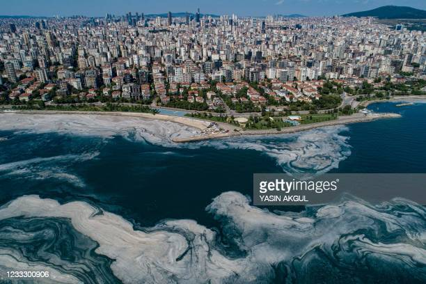 This aerial photograph taken on June 6, 2021 in Turkey's Marmara Sea at a harbor on the shoreline of Istanbul shows mucilage, a jelly-like layer of...
