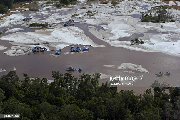 This aerial photograph taken on June 7 2012 in Central Kalimantan province in Indonesia's Borneo island shows an illegal gold mining operation on a...