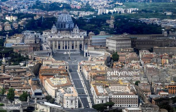 This aerial photograph taken on May 1, 2020 shows St Peter's square and St. Peter's Basilica in the Vatican, during the country's lockdown aimed at...