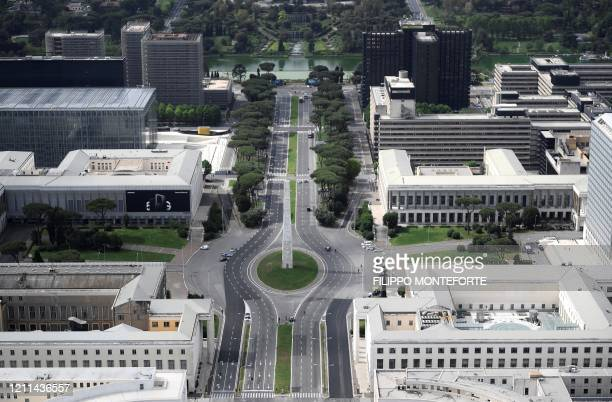 This aerial photograph taken on May 1, 2020 shows the empty Piazza Gugliemo Marconi at the EUR district in Rome, on May day during the country's...