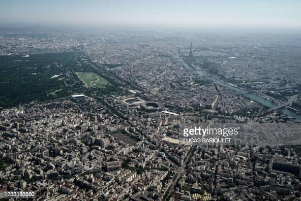 This aerial photograph taken on May 30, 2021 shows the Bois de Boulogne, The Auteuil Hippodrome, Jean Boin Stadium, Parc des Princes stadium, the...