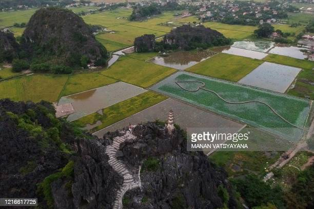 This aerial photograph taken on May 31, 2020 shows tourists visiting the Mua Caves viewpoint in Vietnam's Ninh Binh province.