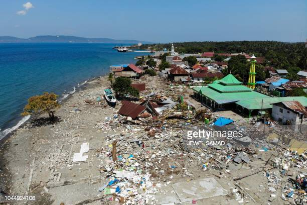 This aerial photograph taken on October 3 2018 shows devastation after tsunami waves swept through coastal houses and buildings in Wani Indonesia's...