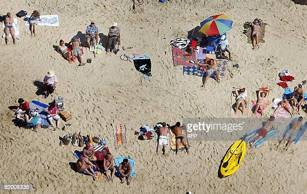 This aerial photography taken on July 19 2008 shows people enjoying the beach along the basin of Arcachon on the French atlantic coast southwestern...