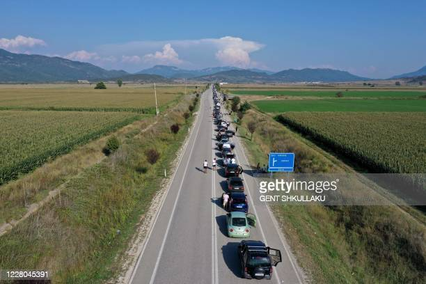 This aerial picture shows a 20-kilometre-long line at the Kakavia border crossing in southern Albania as thousands of Albanians formed an enormous...