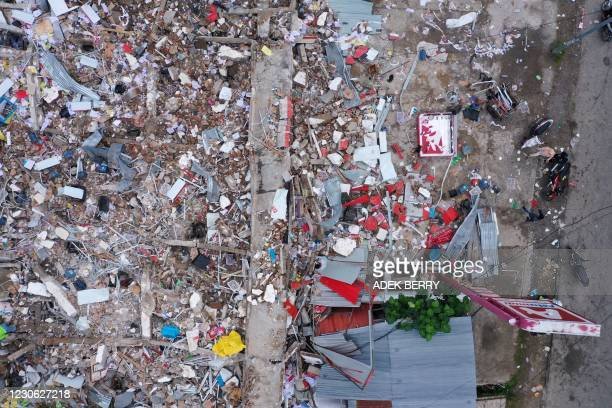 This aerial picture shows a shop damaged following a 6.2 magnitude earthquake in Mamuju on January 17, 2021.