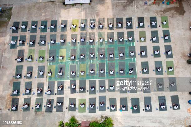 This aerial picture shows members of the Bangladesh police attending a yoga sessionto boost the immune system of police personnel during the...