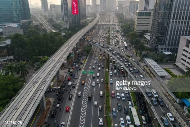 This aerial picture shows motorists commuting on a highway during the afternoon rush hour in Jakarta on May 7, 2021.