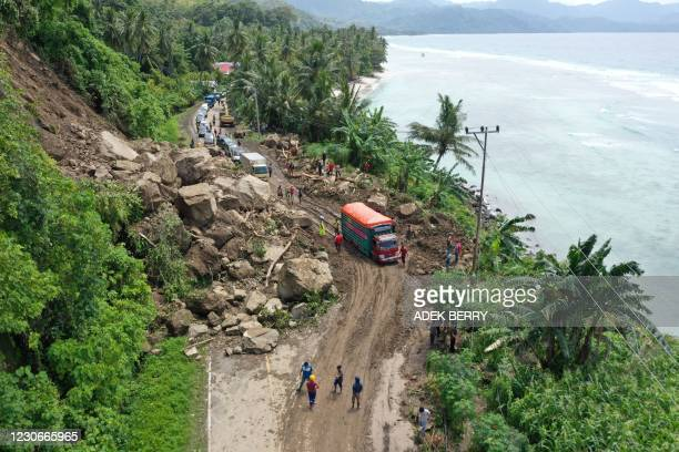 This aerial picture shows motorists waiting in a queue to pass through a section of road affected by a landslide caused by a 6.2 magnitude earthquake...