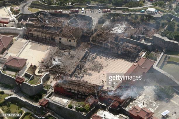 TOPSHOT This aerial picture shows Shuri Castle after a fire ripped through the historic site in Naha Japan's southern Okinawa prefecture on October...