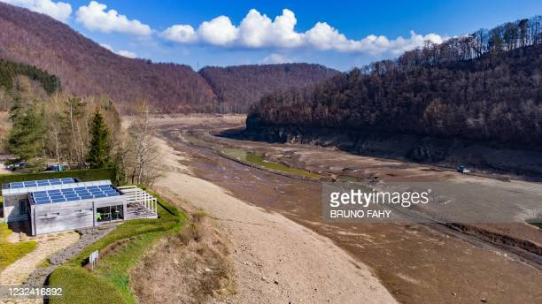 This aerial picture shows the Coo artificial lake, empty of its water, on April 20 in Stavelot. - The lake is being emptied to carry out maintenance...