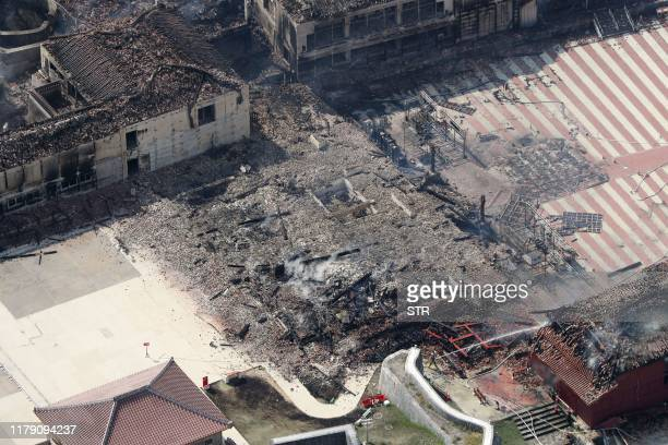 This aerial picture shows the main shrine of Shuri Castle burned down after a fire ripped through the historic site in Naha Okinawa prefecture...