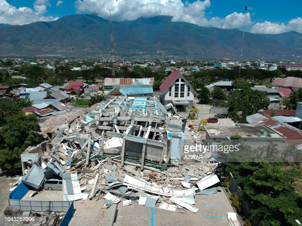 TOPSHOT This aerial picture shows the remains of a tenstorey hotel in Palu in Indonesia's Central Sulawesi on September 30 2018 after it collapsed...