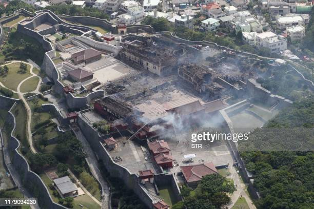 This aerial picture shows the Shuri Castle after a fire ripped through the historic site in Naha Okinawa prefecture southern Japan on October 31 2019...