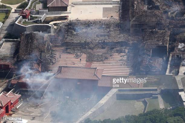 This aerial picture shows the smouldering remains of Shuri Castle after a fire ripped through the historic site in Naha Japan's southern Okinawa...