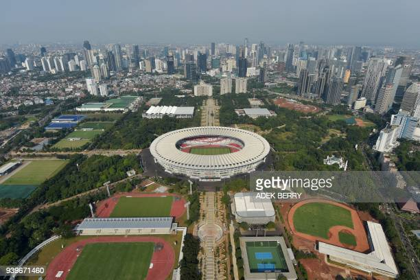 This aerial picture taken from a helicopter shows a general view of the sport facilities at the Gelora Bung Karno stadium and other fields and venues...