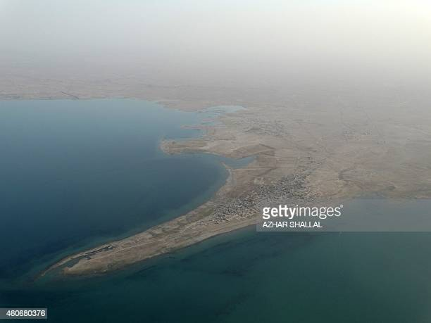 This aerial picture taken from an helicopter on September 6, 2014 shows the banks of the Euphrates river near Haditha dam in the Anbar province....