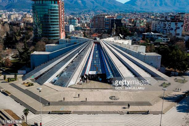 This aerial picture taken in Tirana, Albania, on February 7, 2019 shows a general view of Tirana's pyramid, a former museum that was named after late...