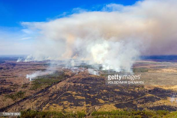 This aerial picture taken on April 12, 2020 shows a forest fire burning at a 30-kilometer Chernobyl exclusion zone in Ukraine, not far from the...