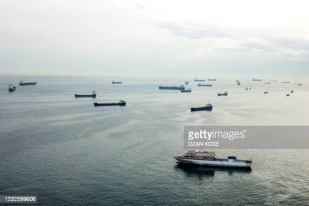This aerial picture taken on April 23, 2021 in Istanbul shows anchored ships wait in the Sea of Marmara before sailing throught the Bosphorus Strait...