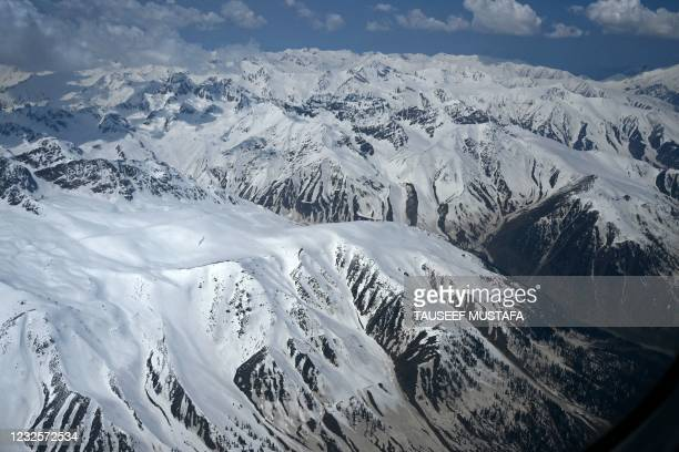 This aerial picture taken on April 28, 2021 shows a view of snow covered mountains in Kashmir region.