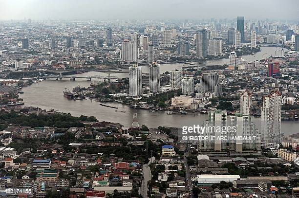 This aerial picture taken on April 5 2014 shows a general view of the skyline and the Chao Phraya river passing through Bangkok The World Bank on...