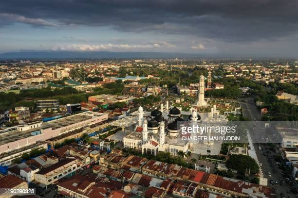 This aerial picture taken on December 10 2019 show a general view of the Baiturrahman mosque in Banda Aceh On December 26 a monstrous 93 magnitude...