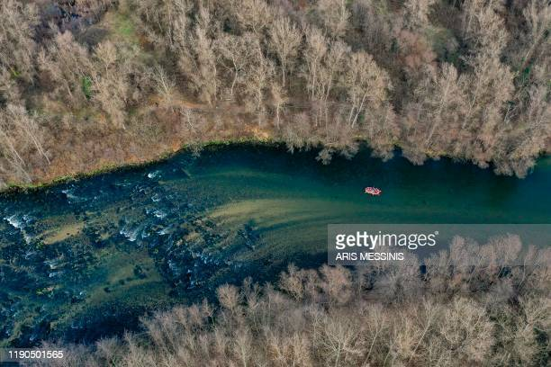 TOPSHOT This aerial picture taken on December 26 shows people rafting on Nestos river near the northern Greek city of Drama