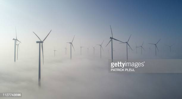 """This aerial picture taken on February 27, 2019 in Jacobsdorf, eastern Germany shows wind turbines in the wind farm """"Odervorland"""" in the Oder-Spree..."""