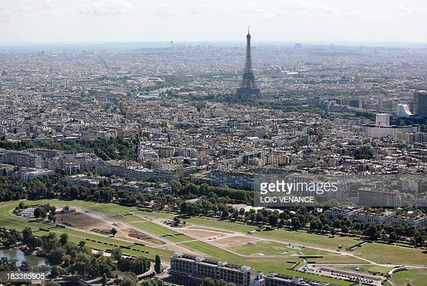 This aerial picture taken on July 14 2009 in Paris shows the Eiffel Tower and the Longchamp horse course AFP PHOTO LOIC VENANCE