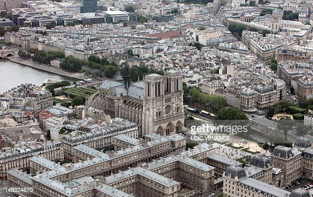 This aerial picture taken on July 14 2012 shows the NotreDame Cathedral on the Ile de la Cite in Paris AFP PHOTO / LOIC VENANCE